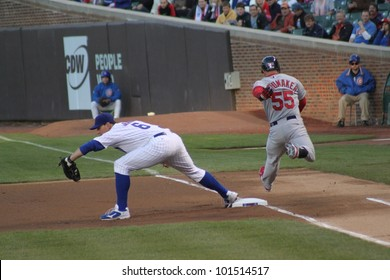 CHICAGO - APRIL 25: Carlos Beltran of the St. Louis Cardinals runs to first base against the Chicago Cubs at Wrigley Field on April 25, 2012 in Chicago, Illinois.