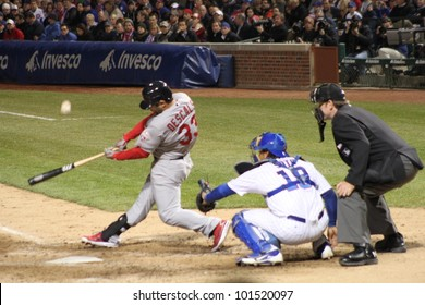 CHICAGO - APRIL 25: Daniel Descalso of the St. Louis Cardinals hits a ball during a game against the Chicago Cubs at Wrigley Field on April 25, 2012 in Chicago, Illinois.