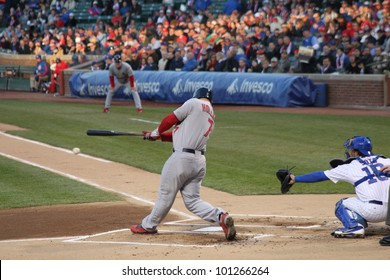 CHICAGO - APRIL 25: Matt Holliday of the St. Louis Cardinals hits a ball during a game against the Chicago Cubs at Wrigley Field on April 25, 2012 in Chicago, Illinois.