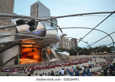 Chicago - August 14: Evening concert performance at the Jay Pritzker Pavilion in Chicago, USA, on August 14, 2015. The Pavilion, designed by Frank Gehry, is an outdoor performing arts venue.