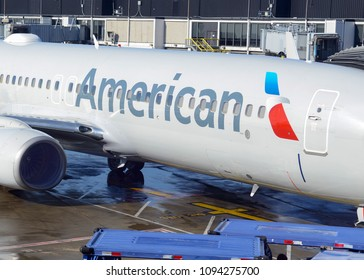 CHICAGO CIRCA APRIL 2018. American Airlines plane in O'Hare Airport Terminal, where American has opened new gates aligned with the growth and expansion in the airport to accommodate increased travel.