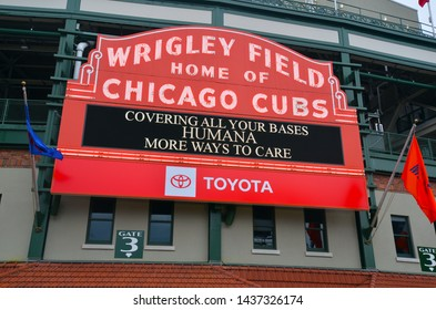 CHICAGO CIRCA JUNE 2019. Wrigley Field baseball stadium in Wrigleyville Chicago is a famous landmark in the city drawing both tourists and enthusiastic fans to watch games