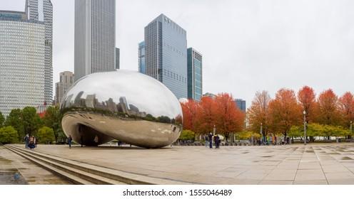CHICAGO - CIRCA OCTOBER 2019: Millennium Park in fall foliage Cloud Gate the bean sculpture