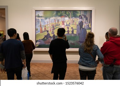 CHICAGO - CIRCA OCTOBER 2019: People watching a painting at a museum