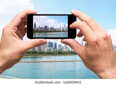 Chicago city, taking picture with smart phone, travel concept