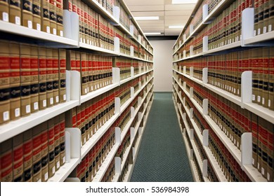 CHICAGO - DECEMBER 2009:  Long shelves of uniform volumes of law case reporters are available on the shelves of a university law school library, as seen in Chicago circa 2009.