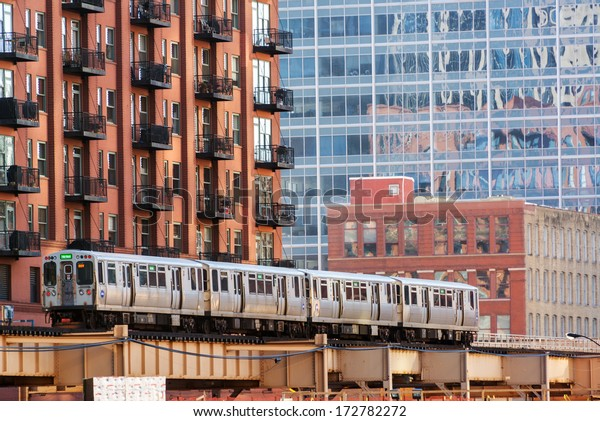 CHICAGO - DECEMBER 28: An elevated train passes through downtown Chicago on December 28, 2013