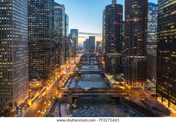 Chicago downtown buildings and river in winter