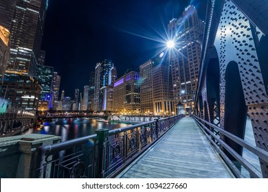Chicago downtown  illuminated view by the river at night from the bridge