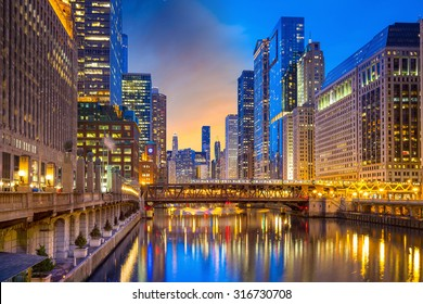 Chicago downtown and Chicago River at night in USA.
