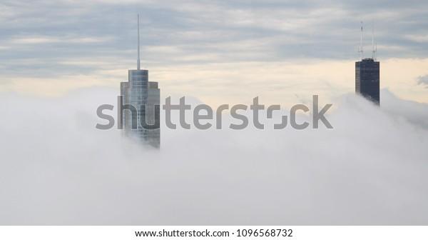 Chicago downtown skyscraper buildings above cloud fog
