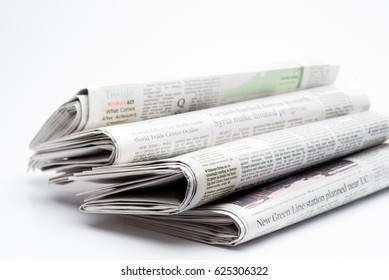 Chicago- Feb 12,2017:  stack of folded newspapers The Wall Street Journal and Chicago Tribune on white background