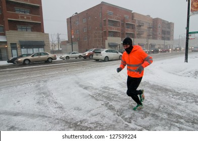 CHICAGO - FEBRUARY 1: A man jogs during a massive winter storm on February 1, 2011 in Chicago. The storm brought as much as 21 inches of snow, making it the third worst blizzard in Chicago history.