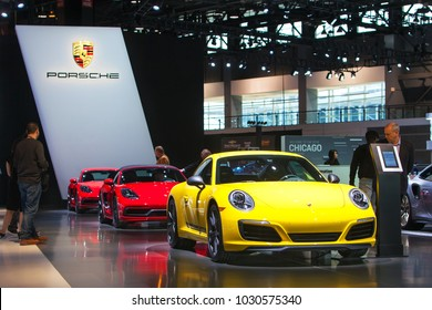 CHICAGO - February 8: A row of Porsche 911 on display at the Chicago Auto Show media preview February 8, 2018 in Chicago, Illinois.