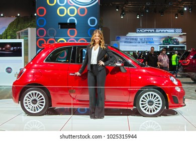 CHICAGO - February 9: A model poses with the 2018 Fiat at the Chicago Auto Show media preview February 9, 2018 in Chicago, Illinois.