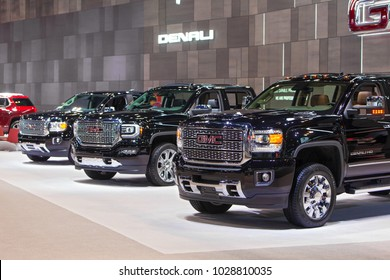 CHICAGO - February 9: A row of GMC Denali trucks on display at the Chicago Auto Show media preview February 9, 2018 in Chicago, Illinois.