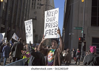 "Chicago, IL, 01/21/2017  Man holding a ""Keep Our Press Free"" sign at the Women's March on Chicago 2017"