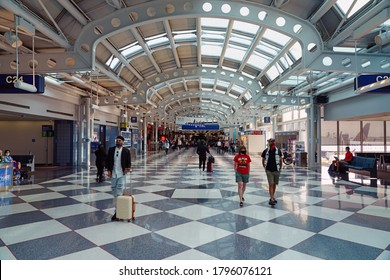CHICAGO, IL -1 AUG 2020- View of people wearing masks at the Chicago O'Hare International Airport (ORD) in Chicago, Illinois, United States.