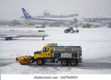 CHICAGO, IL -11 FEB 2018- Planes during a winter snow storm at the Chicago O'Hare International Airport (ORD).
