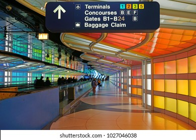 CHICAGO, IL -11 FEB 2018- The colored electric neon tunnel The Sky Is the Limit at Chicago O'Hare International Airport (ORD) connects the B and C concourses at the United Airlines (UA) terminal.