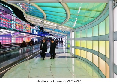 CHICAGO, IL -2 DECEMBER 2015- The colored electric neon tunnel The Sky Is the Limit at Chicago O'Hare International Airport (ORD) connects the B and C concourses at the United Airlines (UA) terminal.