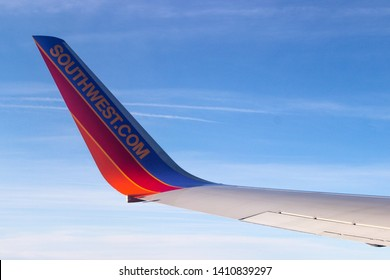 Chicago, IL - 2018. Wing of a Southwest Airlines Airplane Boeing 737-800 as seen from window midflight with a clear blue sky