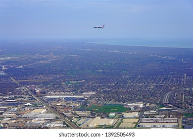 CHICAGO, IL -21 APR 2019- Aerial view of an airplane from American Airlines (AA) in the air in approach at Chicago O'Hare International Airport (ORD).