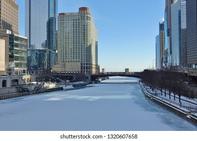 CHICAGO, IL - 30 JAN 2019- View of the frozen Chicago River covered with snow during a record-breaking cold spell in Chicago in January 2019.