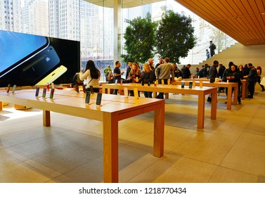 CHICAGO, IL -31 OCT 2018-  View of a large flagship Apple store over several stories by the Chicago River in Chicago, Illinois.
