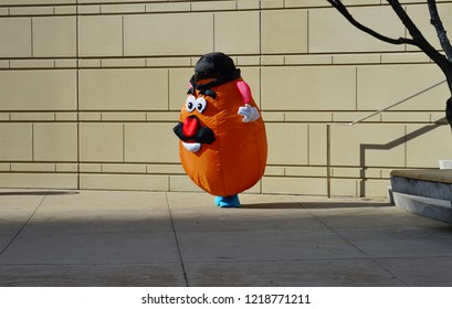 CHICAGO, IL -31 OCT 2018-  View of a person in a Mr. Potato Head costume on the day of Halloween by the Chicago River in Chicago, Illinois.