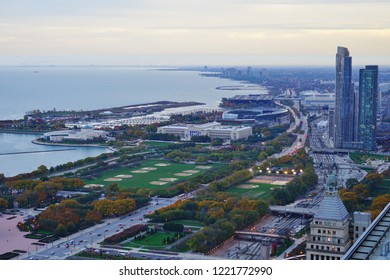 CHICAGO, IL -31 OCT 2018- Aerial view at sunset of Grant Park, Lake Michigan, and the skyline cityscape in the South Side of Chicago seen from the Loop in downtown Chicago, Illinois.