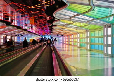 CHICAGO, IL -7 APR 2017- The colored electric neon tunnel The Sky Is the Limit at Chicago O'Hare International Airport (ORD) connects the B and C concourses at the United Airlines (UA) terminal.