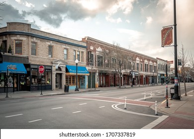 Chicago, IL - April 15th, 2020: Clark Street sits completely empty and quiet in Andersonville during the COVID-19 pandemic outbreak and stay at home orders as many businesses remain closed down.