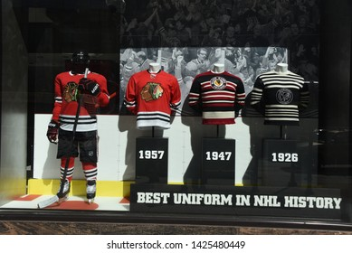 Chicago, IL April 26, 2019, NHL National Hockey League Chicago Blackhawks old vintage jerseys on display at the Blackhawks store front windows