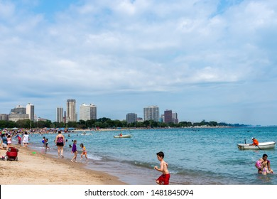 CHICAGO, IL - AUGUST 16, 2019: The public enjoying North Avenue Beach while waiting for the Chicago Air and Water Show rehearsals to begin .