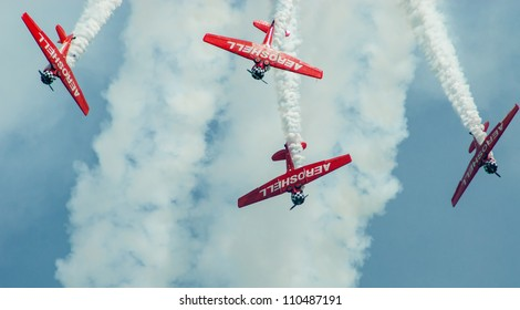 CHICAGO, IL - AUGUST 18: Aeroshell team of aerobatic planes maneuver their planes during airshow on Chicago Lakefront August 18, 2012 in Chicago, IL.
