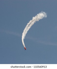 CHICAGO, IL - AUGUST 18: A member of the Team Oracle's Extra 300 airplane performs a low pass over Lake Michigan during airshow on Chicago Lakefront August 18, 2012 in Chicago, IL.