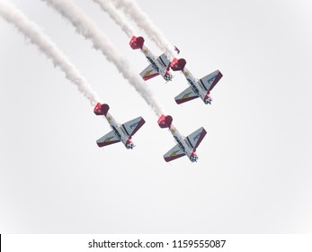 Chicago, IL - August 18th, 2018: The Aeroshell aerobatic team performs stunts leaving trails of smoke over the city and entertaining the crowds watching from below at the annual Air and Water show.