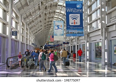 CHICAGO, IL - AUGUST 21, 2006: Unidentified Travelers walk to gates at Chicago O'Hare International Airport in USA. It was the 5th busiest airport in the world with 66,883,271 passengers in 2013.