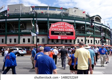 Chicago, IL - August 22, 2019: Fans stream across the intersection of Clark and Addison at Wrigley Field before a Chicago Cubs baseball during a beautiful summer day