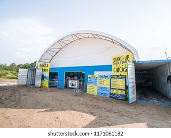 Chicago, IL - August 25th 2018: A new structure built using an arched tent-like roof structure over blue shipping containers arranged in a square shape at Montrose Beach gives Kayak Chicago a new home