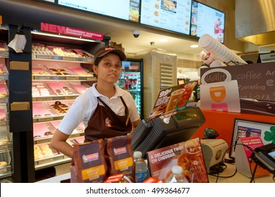 CHICAGO, IL - CIRCA MARCH, 2016: indoor portrait of staff at Dunkin' Donuts in Chicago. Dunkin' Donuts is an American global donut company and coffeehouse chain.