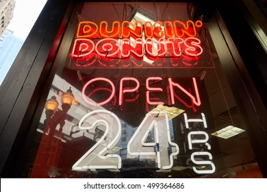 CHICAGO, IL - CIRCA MARCH, 2016: close up shot of Dunkin' Donuts open 24 hours sign. Dunkin' Donuts is an American global donut company and coffeehouse chain.