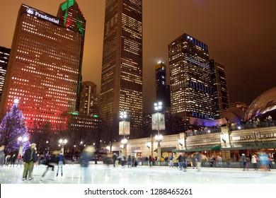 Chicago, IL - DEC 27, 2018: Evening scenery of Chicago downtown skyline in Millennium Park, Chicago, Illinois USA
