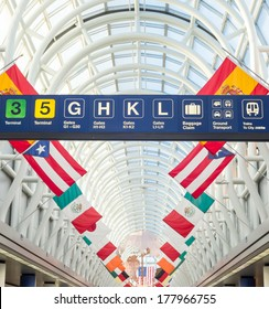 CHICAGO, IL - FEB 10 2014: Terminal 3 of O'hare Internation Airport on February 10th 2014. Terminal 3 Hall of Flags represents a country that American Airlines serves non-stop from O'Hare