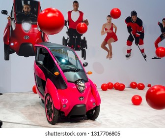 CHICAGO, IL - FEBRUARY 9: Toyota showroom with i-Road concept car in composition with red balls at the annual International auto-show, February 9, 2019 in Chicago, IL