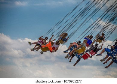 CHICAGO, IL, July 02, 2017: Children  ride the  wave swinger, at Navy Pier, which attracts more than nine million visitors each year.