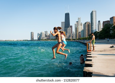 CHICAGO, IL - JULY 11: unidentified teenagers jump in Lake Michigan on July 11, 2012 in Chicago, IL