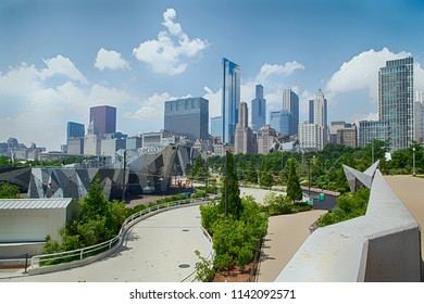 CHICAGO, IL, July 15, 2018: Chicago downtown skyline. Public BP walkway in Millenium park in Chicago, IL. Millenium Park is the second most popular public attraction in the city of Chicago.