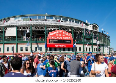 Chicago, IL - July 16, 2016: Fans stream across the intersection of Clark and Addison streets at Wrigley Field after a Chicago Cubs baseball during a beautiful summer day.